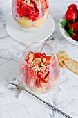 Creamy custard with crumble, egg liqueur and strawberries