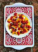 Grilled peaches with sun-dried tomatoes on tray