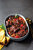 Tomato and chilli oxtail with butter beans