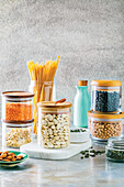 Condiments from the pantry - beans, lentils, pasta, almonds and pumpkin seeds