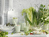 An arrangement of various dairy products with herbs