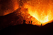 Tourists watching a volcano eruption, Iceland