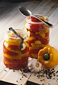 Jars of yellow and red peppers