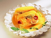 Fruit jelly terrine with mango puree