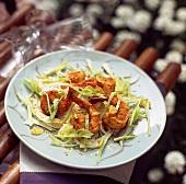 Salad of prawns sautéed with turmeric and sesame