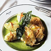 Roasted monkfish with onions and basil