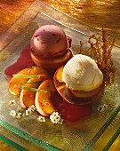 Roast peaches with peach and strawberry ice cream