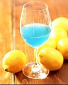 Cocktail blue devil gin with lemon juice maraschino liqueur and blue curacao