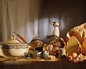 soup tureen and dairy product ingredients - cheese, eggs, butter
