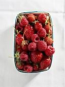 Carton of raspberries and strawberries