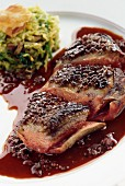 Duck magret, skin with honey and cabbage embalmed