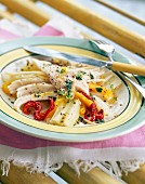 Flaked marinated skate marinated with fennel and peppers