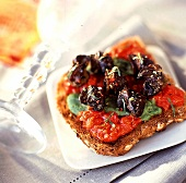 Snails on toast with parsley and tomato butter
