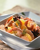Prawns in stock with orange and grapefruit