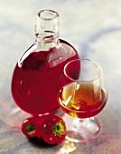 carafe and glass of strawberry liqueur