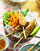 meat and sesame seed kebabs with noodles