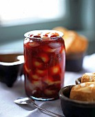 Raspberry and peach jelly in glass