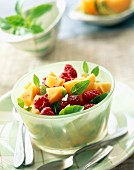 Melon and raspberry salad with basil