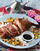 Half a Peking duck with soy sauce, oriental dish