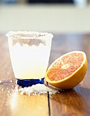 Margarita cocktail with grapefruit half