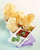 Filo pastry parcels with caramelized vegetables, tomato and coriander purée