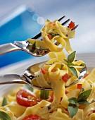 Fettucini pasta with tomato and basil