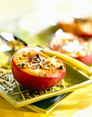 Grilled peach half with pistachios
