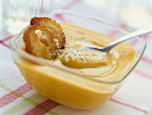 Creamed yellow pepper soup with croutons
