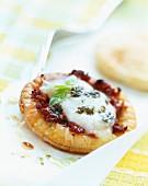 Mini flaky pastry tart with tomato