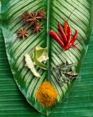 Selection of spices on palm leaf