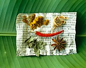 Selection of spices on newspaper