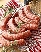 Uncooked Toulouse sausages on rack