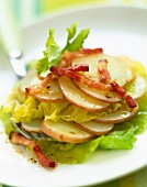 Warm potato, lettuce and diced bacon salad
