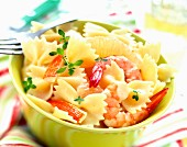 Pasta bow salad with prawns and surimi