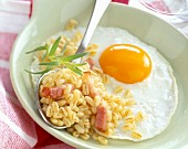 fried egg with wheat and diced bacon