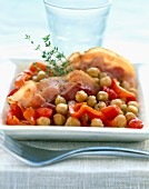 Salt pork bacon with chickpeas and red peppers
