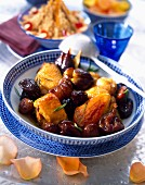 Capon Tajine with chestnuts, prunes and figs