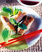 crispy rolls with beef and herbs spring onions