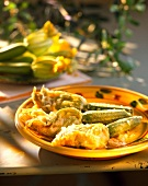 Stuffed courgette flower fritters