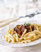 Macaroni with stewed beef and onions