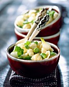 Gnocchi with fresh broad beans and onion shoots