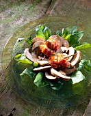 Raw button mushroom salad with mussels wrapped in bacon