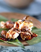 Rabbit skewers with barbecue sauce