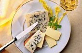 Plate of Roquefort cheese and butter with knife
