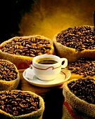 sacks of coffee beans and cup of coffee