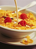 cornflakes and milk with raspberries