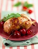 Free-range quail with fresh cherries