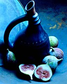 A traditional jug and fresh figs