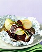 Pears with chocolate sauce cooked in aluminium foil