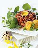Beef tartare with capers, gnocchi and quail eggs
